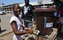 Student at Gibson High School in Monrovia, Deborah Natt,16, is smiling to be back at school. At every entrance there is a handwashing station.