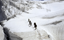 A research team crossing an ice plateau in the Indian Himalayas faced risks of hidden crevasses, storms, avalanches and earthquakes.