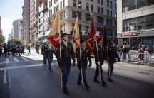 US Army Reserve color guard soldiers carry the colors on Fifth Avenue during the annual New York City Veterans Day Parade in New York, Nov. 11, 2017.