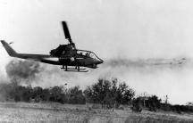 A US Huey Cobra fires rockets at an enemy target in Ia Drang, October 1965.