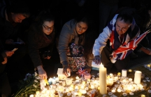 People light candles at a vigil in Trafalgar Square the day after an attack, in London, March 23, 2017.