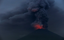Glowing light from hot lava is seen during the eruption of Mount Agung in Bali, Indonesia, Nov. 27, 2017.