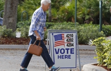 A voter walks to a polling precinct