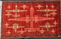 Predator drones featured on a hand-woven rug from Pakistan.