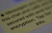 An encryption message is seen on the WhatsApp application on an iPhone.