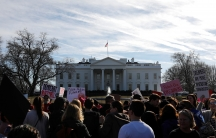 People participate in the second annual Women's March outside the White House in Washington