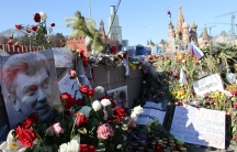 Supporters of Russian opposition leader Boris Nemtsov continue to leave flowers on the bridge where he was shot down more than two weeks ago, within view of the Kremlin.