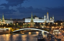Moscow's Kremlin and the Bolshoy Kamenny Bridge are seen in the late evening.