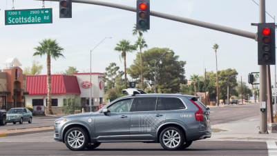 A self-driving Volvo vehicle, purchased by Uber, moves through an intersection in Scottsdale, Arizona, Dec. 1, 2017.