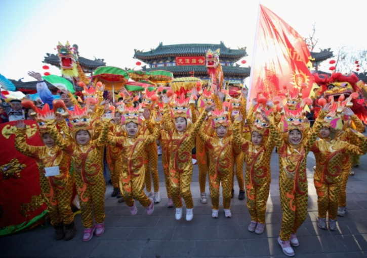 chinese young performers dressed in dragon costumes perform at a temple fair to celebrate the lunar new year of dragon on jan 22 2012 in beijing china - Chinese New Year 2012