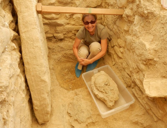 Sharon Stocker with the 3,500 year-old skull found in the warrior's tomb. (University of Cincinnati, Pylos Excavations)
