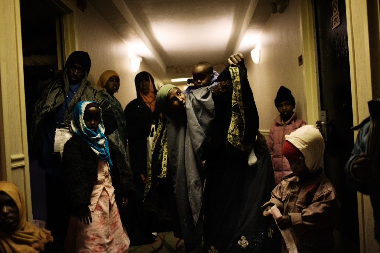Despite the care provided by the International Organization for Migration, Somali refugees opted to spend the night in a hotel hallway. Some of them feared being left behind on their trip to their resettlement destination. December, 11, 2009.