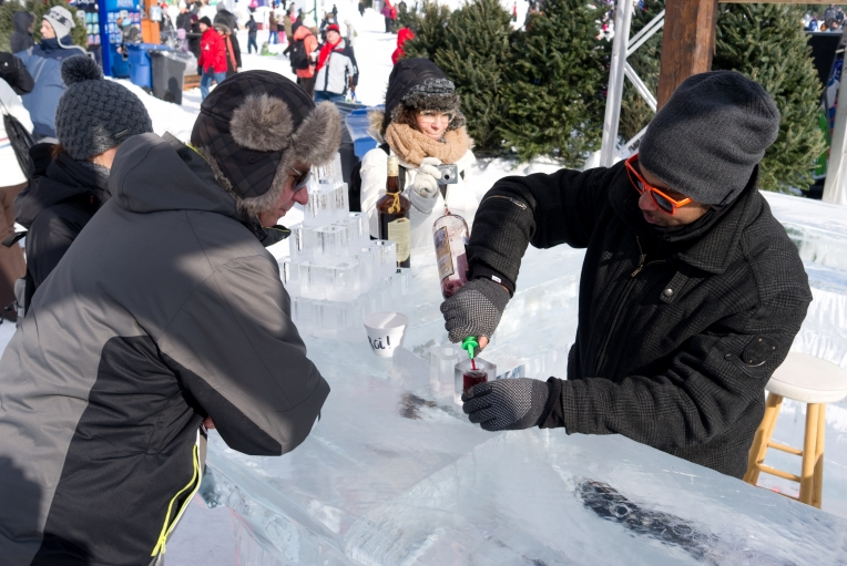 "Bellying up to the ice block on Quebec's carnival grounds. ""Don't put your change on the bar,"" the bartender tells a customer. ""It will stick. And don't even think about your tongue."""