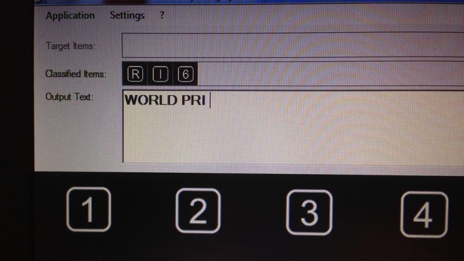 "Reporter Daniel Estrin spells out ""World PRI"" using a mind-reading cap that is intendiX, a technology which allows patients who cannot communicate to to spell out words by concentrating on letters on a screen."