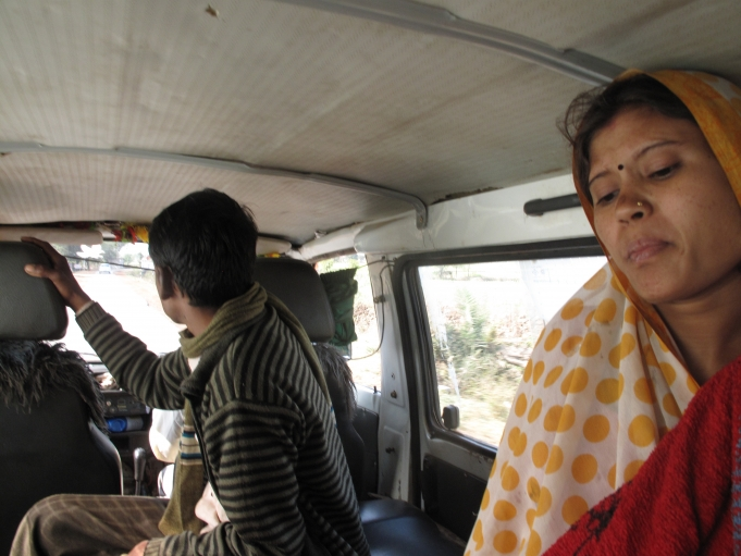 A Janani Express ambulance transports Laali Jatav, 21, from a village called Nanora to the nearest hospital. Her husband (left) accompanies her.