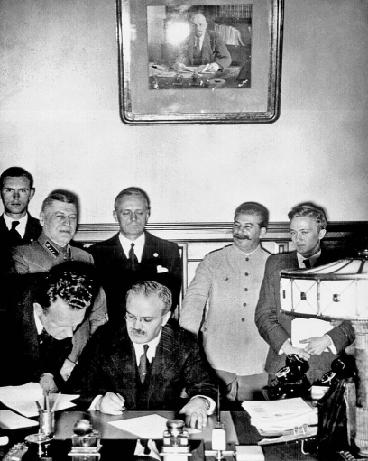 Molotov and Ribbentrop sign the Non-Aggression Pact, 23rd August 1939, with Stalin looking on.