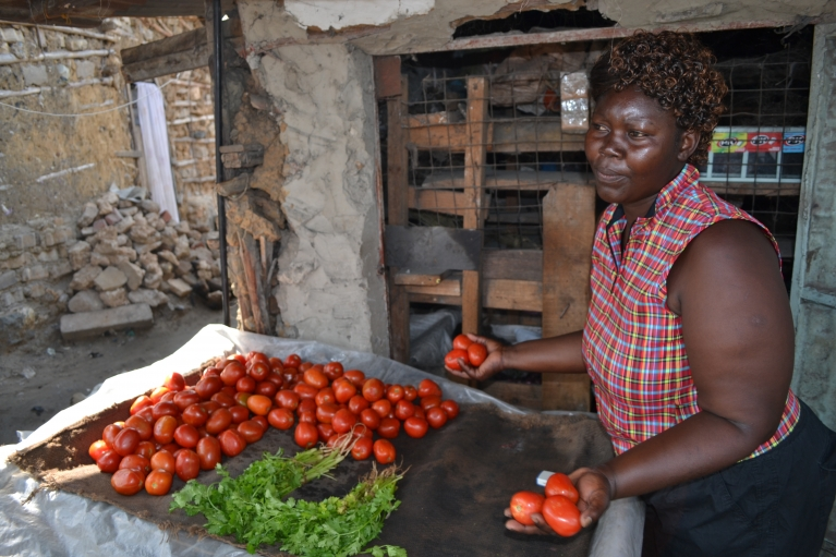 Emma Onyango sells vegetables at a stand on the main street. She's one of the founding members of the Bangla-Pesa exchange.