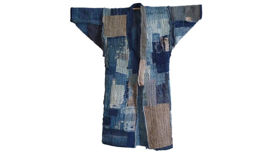 This is a boro, long work-coat called a nagagi. Very thick, with layers, because it's been patched so many times. Abrasions to the surface of the coat come from decades of wear. These kinds of coat were handed down through generations and worn by many dif