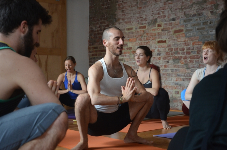 Greg Marzullo teaches yoga class in Washington