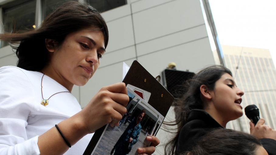 Gabriela García, who came to the US illegally from Mexico when she was three with her mother, helped lead a recent pro-immigrant rights rally in San Francisco. The photograph on the back of her clipboard shows a woman deported to Latin America.