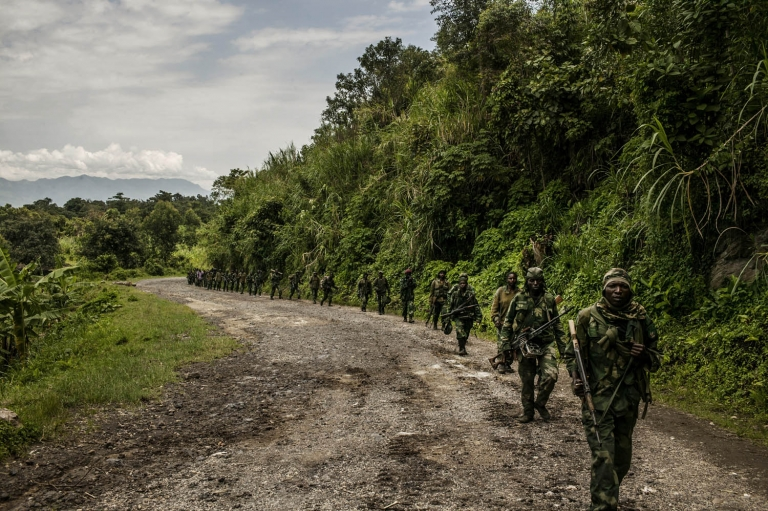 Congolese soldiers advance up the mountainous road toward Bunagana, the last remaining stronghold of the M-23 rebels on Wednesday.
