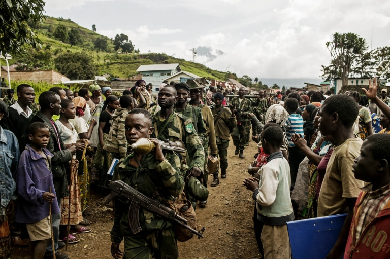 Congolese soldiers are greeted by cheering crowds in Bunagana, the last remaining stronghold of the M-23 rebellion.