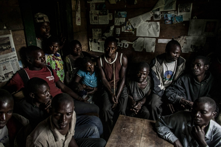 The men of the Kanyabugoyi family gather inside their family home in the village of Rugare, which was recently wrest from M-23 rebels by the Congolese army. The family fled their home in August after being continually harassed by M-23 rebels.
