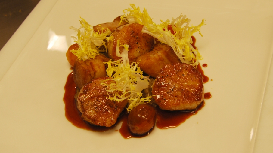 At Andrea's, an Asian fusion restaurant at the five-star Wynn & Encore Resort on the Las Vegas Strip, pan-seared diver scallops with eggplant puree highlight Filipino cuisine. Chef Joseph Elevado says Filipinos are his biggest fans - and critics.