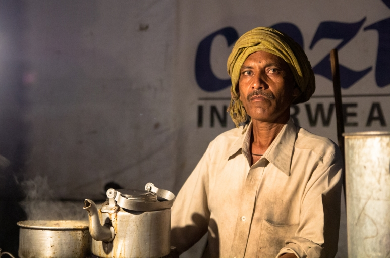 Ganesh, a chai wallah at the Patna train station, brews one of his last pots of the night.