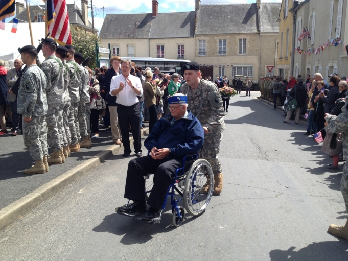Veterans entered a D-Day ceremony in a procession in the Normandy town of La Cambe.