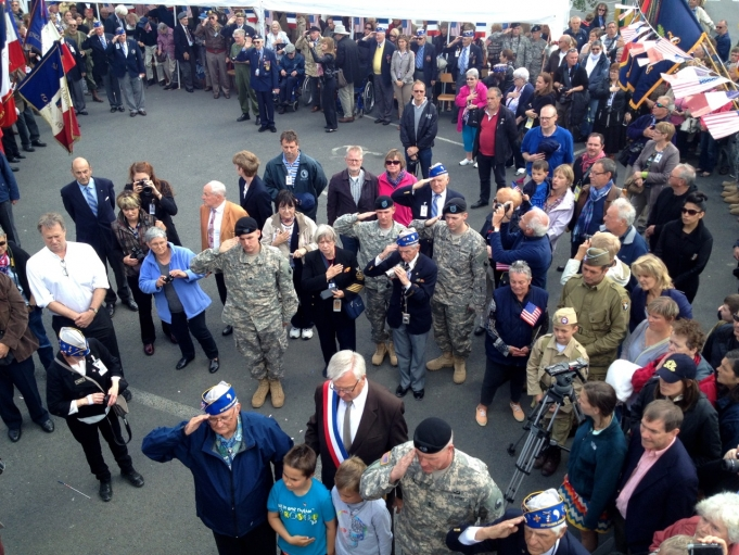 Active duty soldiers, locals and tourists gathered in La Combe to salute D-Day veterans at a ceremony.