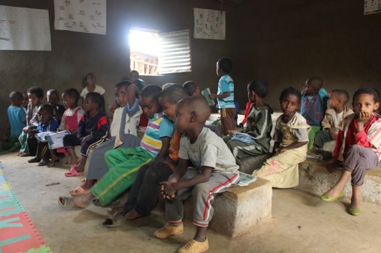 Children attend kindergarten in Awra Amba.