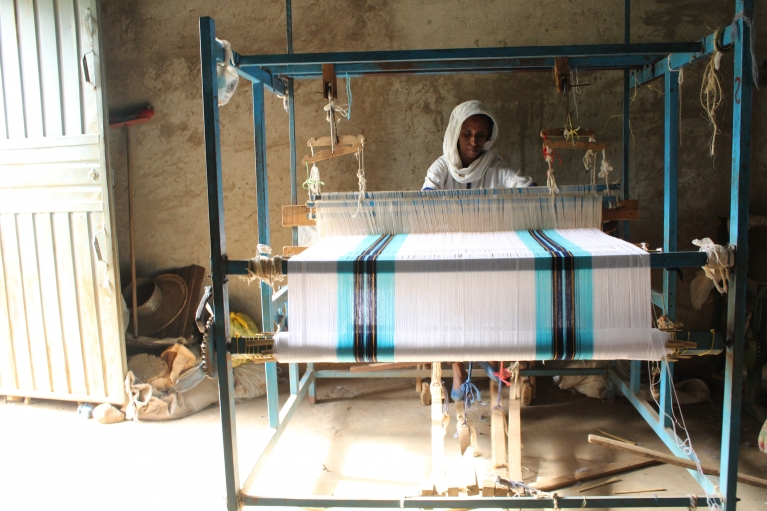 A woman at Awra Amba's weaving factory.