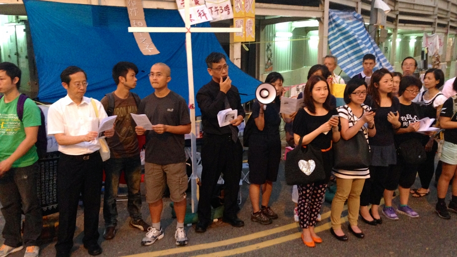 A group of Christian faithful gathered at a protest site in Hong Kong's financial and government district on Sunday evening to sing hymns and say prayers.