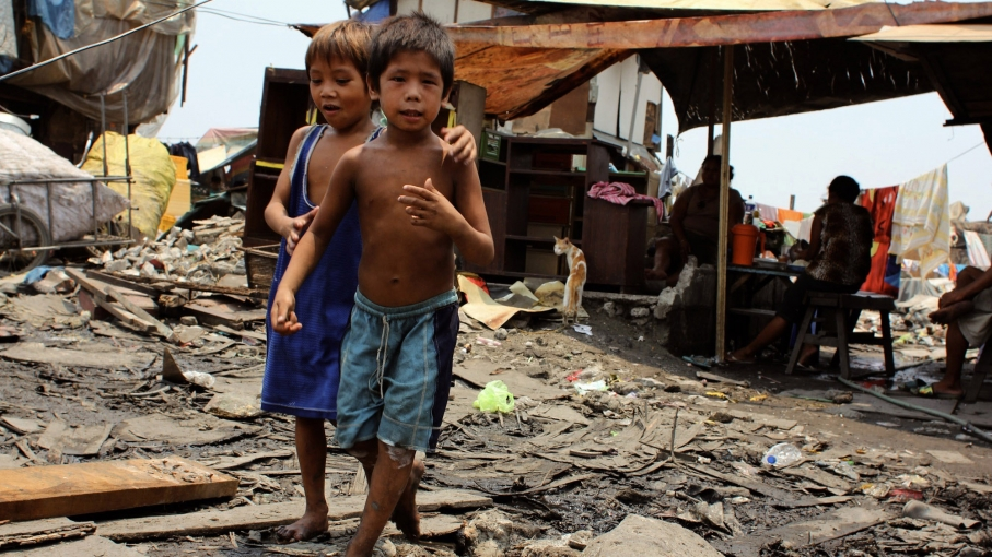 Children play in the streets of Sitio Damayan, where Ana Lisa Loste moved after Smokey Mountain, when the garbage dump where she was raised was shut down by the government. This area, which smells of rotting trash from the junk shops down the road, is wid