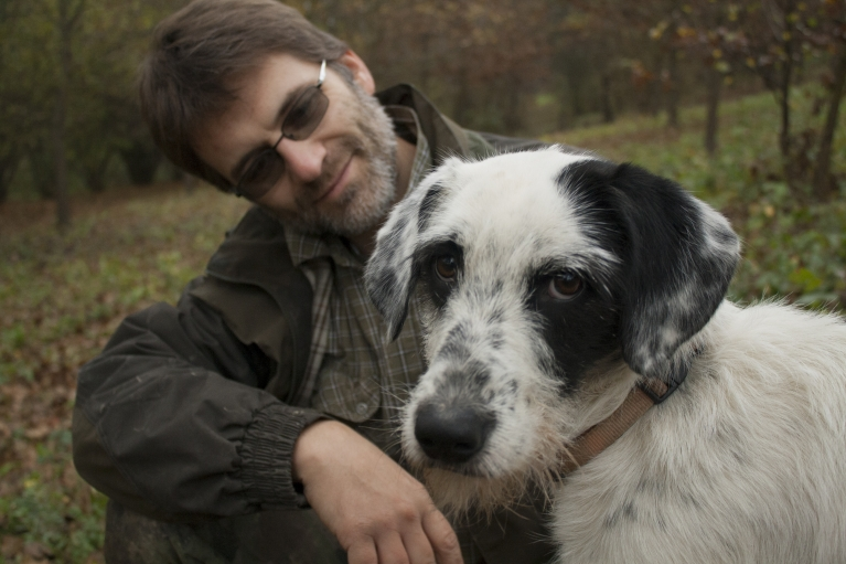 A moment of rest for Truffle hunter Walter Tedesco and his hunting dog, Leo.