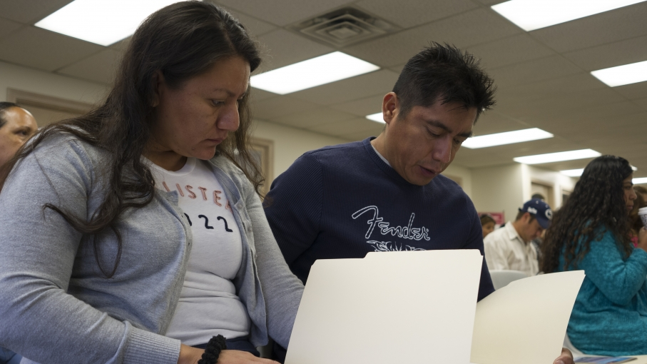 "Eliseo Toledano and his wife, Francisca Lemus, study a practice test for the California driver's exam. Toledano learned to drive from friends in the US, but he has never had a license. ""Of course, you know how to drive on the highway,"" he says. ""But there"