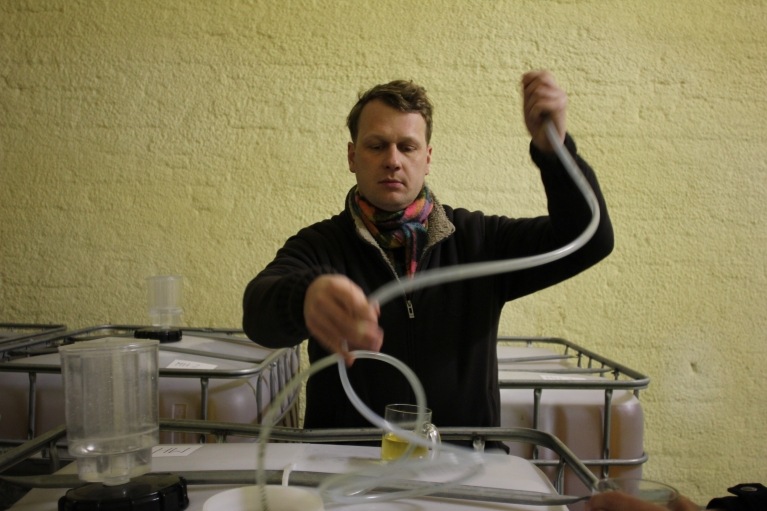 Marcin Hermanowicz checks on the status of a 2013 batch of artisanal cider.