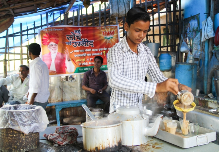 Munna, a chai wallah in Patna's Mandiri district, makes chai at a NaMo Tea Stall, part of Indian opposition leader Narendra Modi's campaign to sway voters through his humble past as a chai wallah.