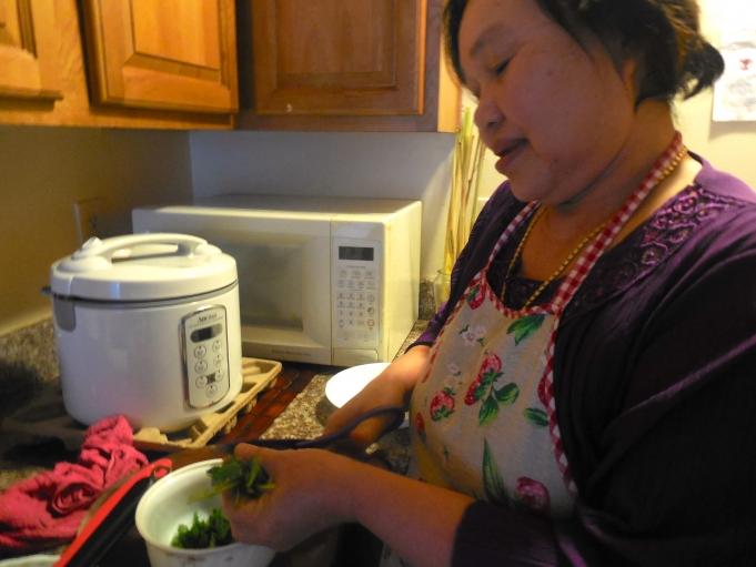 Cho Mei's mother, Naw Htoo, prepares a traditional Burmese soup using coconut milk, lemon grass and cilantro.