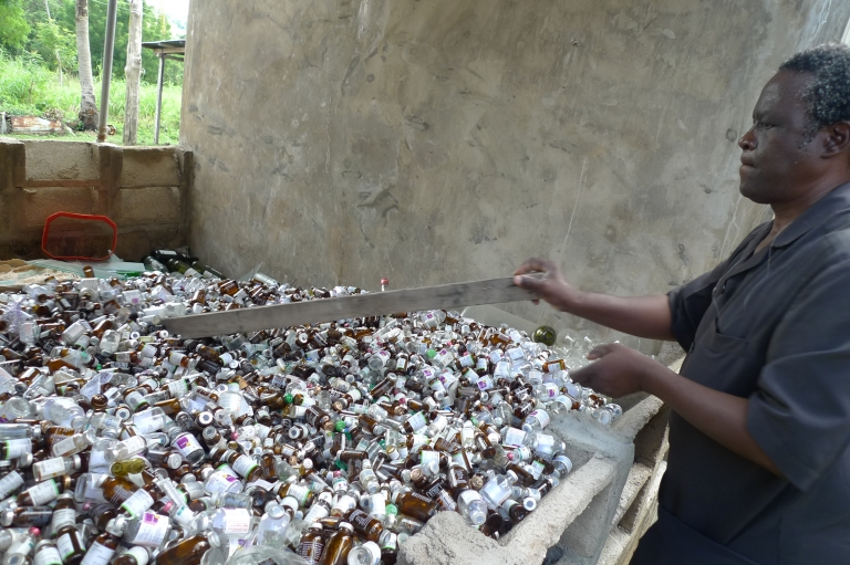 """""""Everything that doesn't degrade, we hold onto it so that it may be of use in the future,"""" Dr. Awojobi says. He plans to melt down these bottles, which used to contain injectable medicines, to produce drinking glasses."""