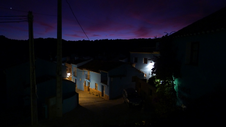 Smurfville, Spain - formerly known as Juzcar - after dark. All but one of the 400 residents painted their homes blue in order to attract tourists. It's worked.