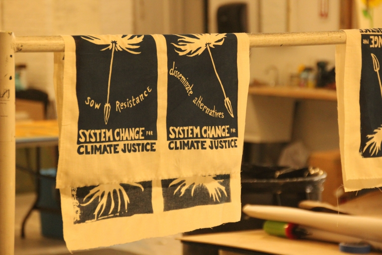 Freshly minted protest signs  for the People's Climate March dry at Be Electric art space in Bushwick, Brooklyn.