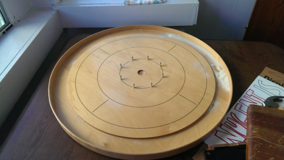One of Scott's practice boards. Players can rub their game pieces in granular shuffleboard wax to make them go faster.