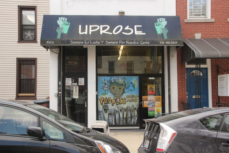 Painting and posters about the People's Climate March adorn the front of UPROSE in Sunset Park, Brooklyn. The organization focuses on climate justice and adaptation and is one of the main groups behind the climate march.