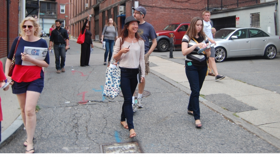 "Graphic designer Kate McLean (center with hat) leading a ""smell tour"" in Boston."