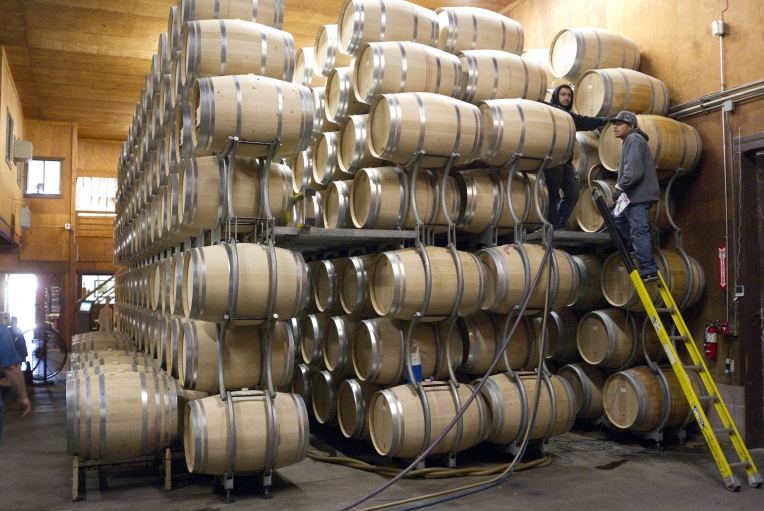 Barrels of Grgich Hills wine are racked at the winery in Napa Valley.