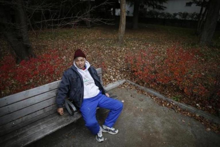 Shizuya Nishiyama, a 57-year-old homeless man from Hokkaido, rests on a bench at a park near Sendai Station in Sendai, northern Japan, December 18, 2013.