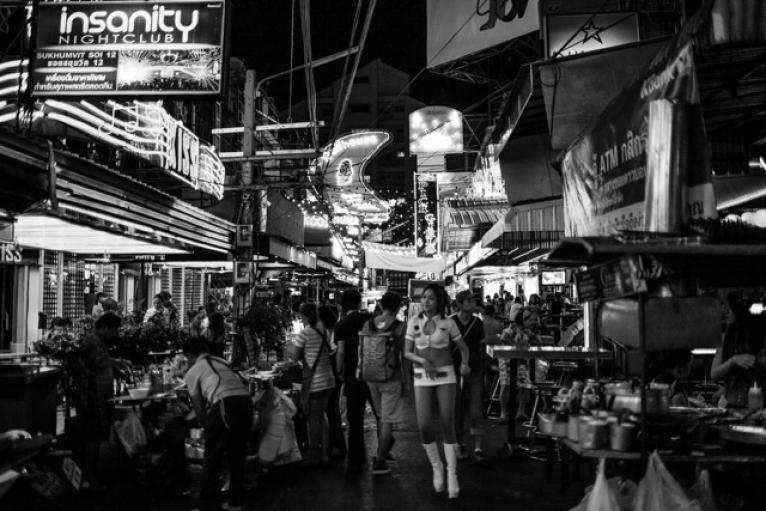 """""""Soi Cowboy"""", or """"Cowboy Alley"""", is named for an American Vietnam War veteran who opened one of the first bars on the street, and is one of Bangkok's most famous sex tourism districts."""