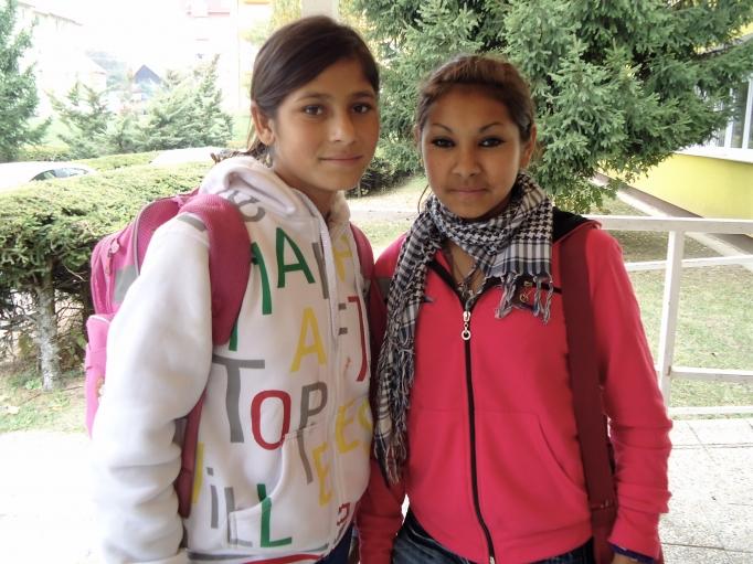 Two eighth-grade Roma students leave Šarišské Michaľany school for the day.